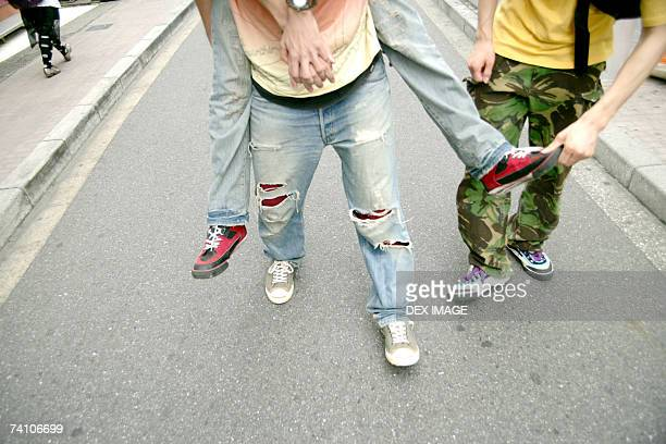 Low section view of a person giving piggy back to another person