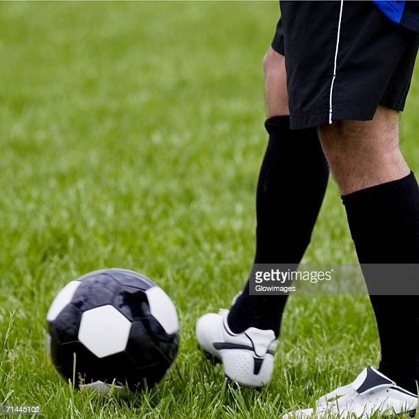 Low section view of a soccer player with a soccer ball
