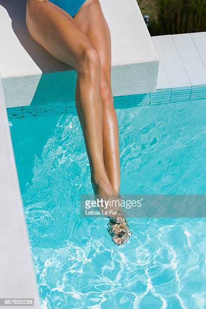 low section view of a woman at the poolside - human foot stock pictures, royalty-free photos & images