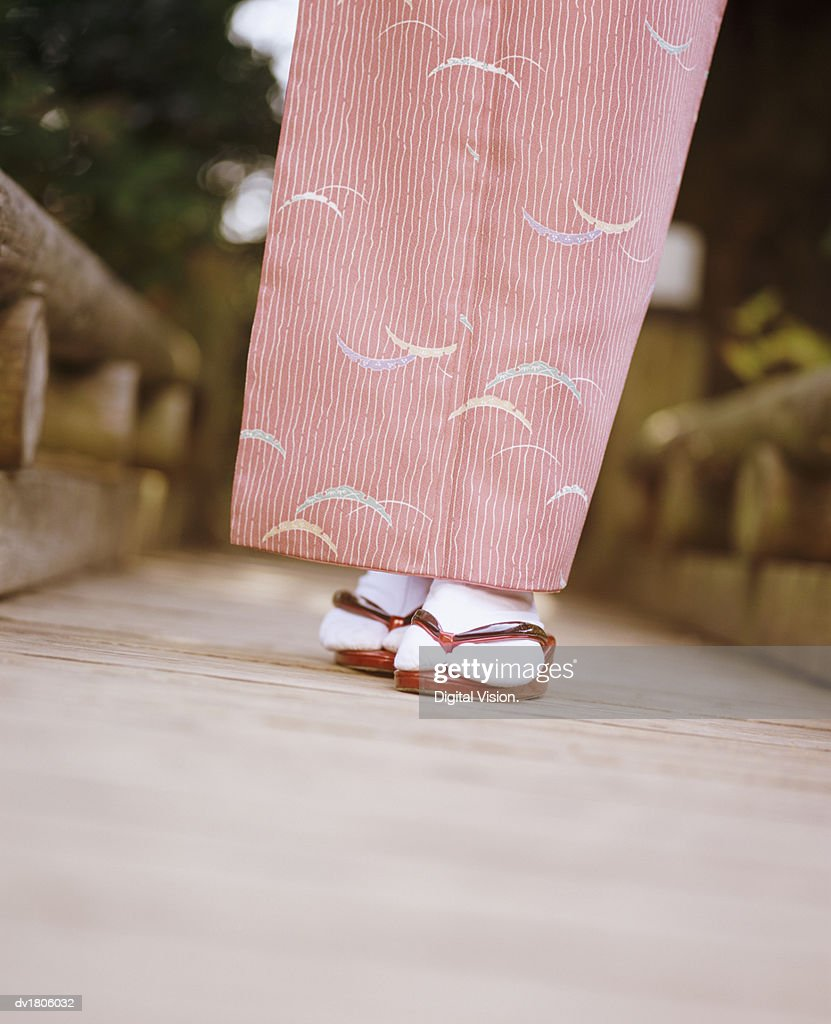 Low Section View of a Woman Wearing a Kimono and Japanese Sandals : Stock Photo