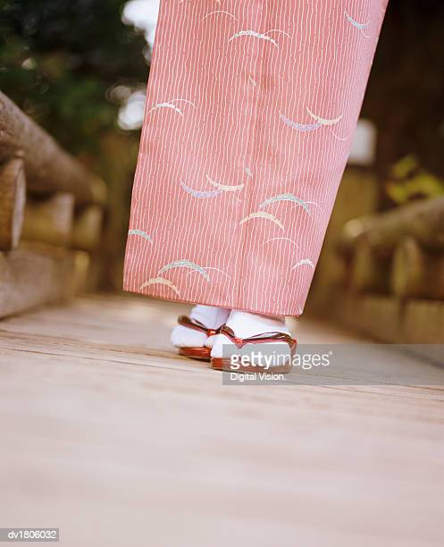 Low Section View of a Woman Wearing a Kimono and Japanese Sandals