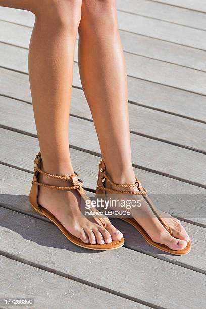 low section view of a woman wearing sandals - open toe stock pictures, royalty-free photos & images