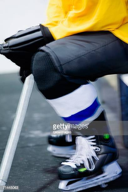 low section view of an ice hockey player in a uniform - ice hockey glove stock pictures, royalty-free photos & images