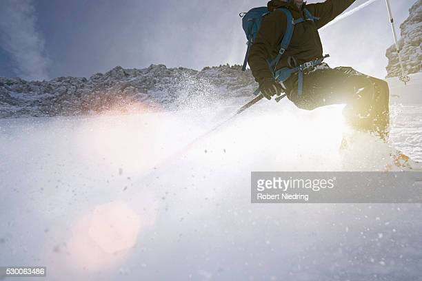 low section view of man skiing, bavaria, germany - sport d'hiver photos et images de collection
