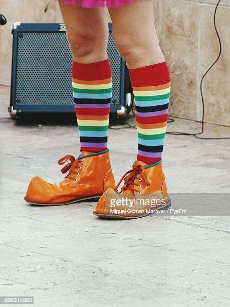 Low Section View Of Person With Colorful Socks And Boot