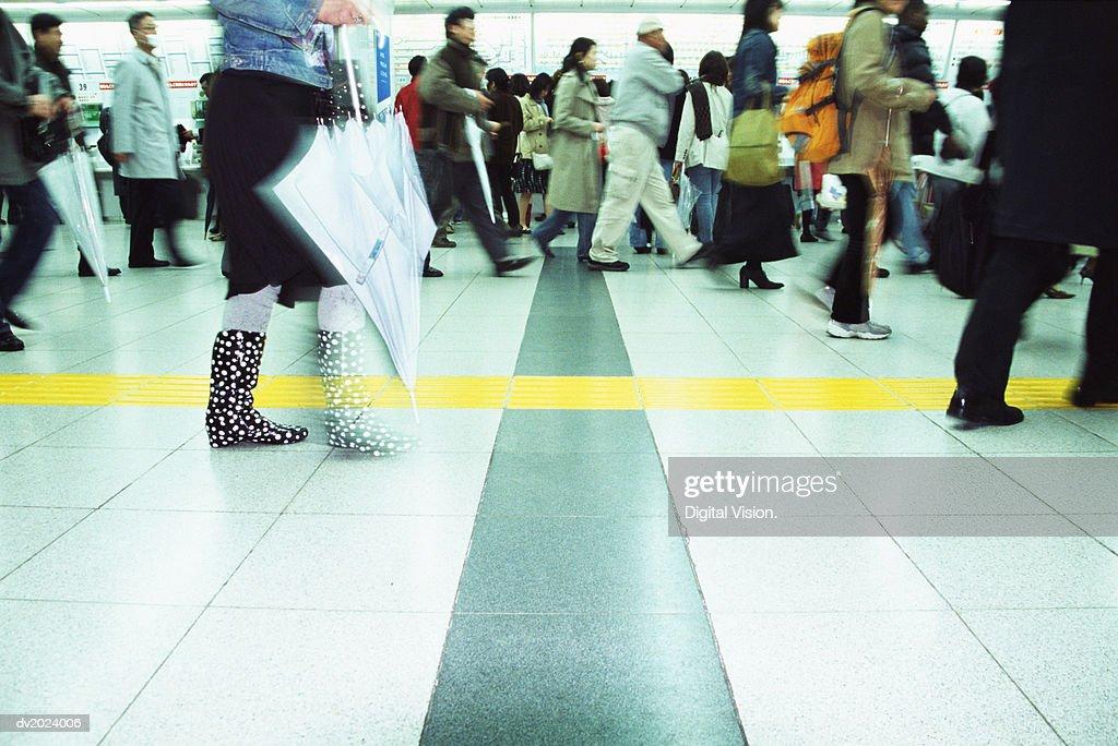 Low Section View of Walking Commuters, Shinjuku, Tokyo, Japan : Stock Photo