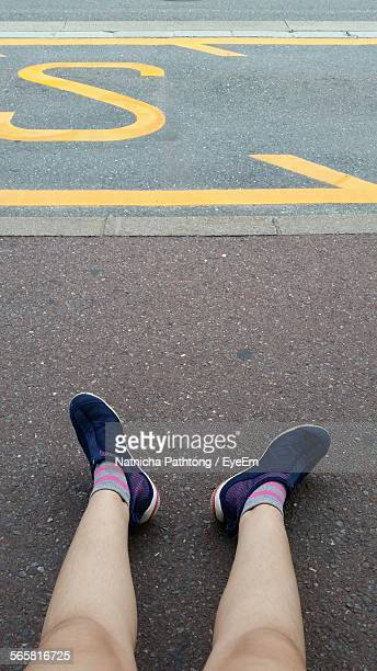 Low Section View Of Woman On Road
