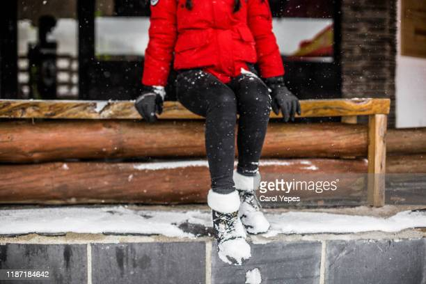 low section woman with boots covered in snow - レギンス ストックフォトと画像