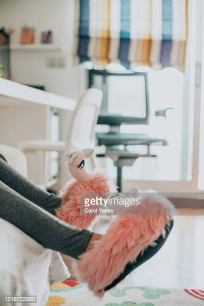 low section young legs in flamingo slippers - fluffy stock pictures, royalty-free photos & images