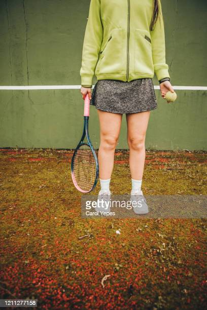 low section young woman in tennis clothes - racquet stock pictures, royalty-free photos & images