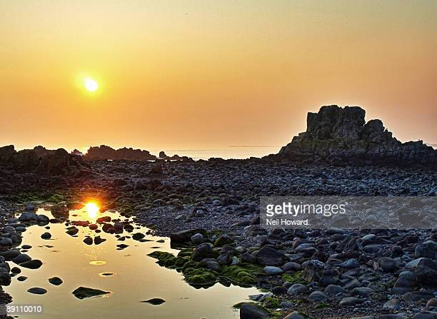 low setting sun reflected in a rocky pool - howard,_wisconsin stock pictures, royalty-free photos & images