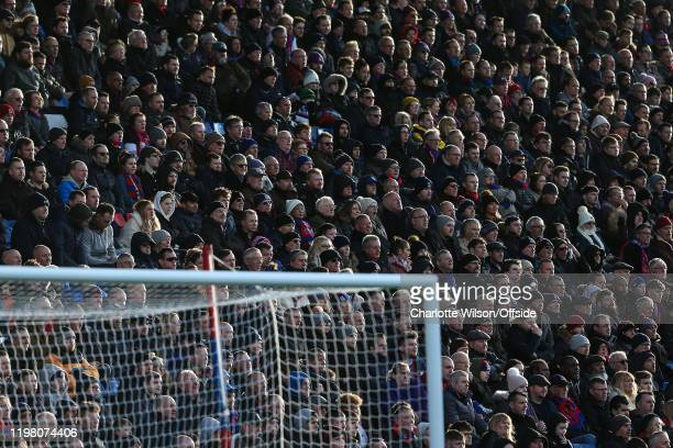 Low sunlight falls across the crowd at Selhurst Park during the Premier League match between Crystal Palace and Sheffield United at Selhurst Park on...