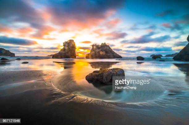 low tide at bandon beach - oregon coast stock pictures, royalty-free photos & images