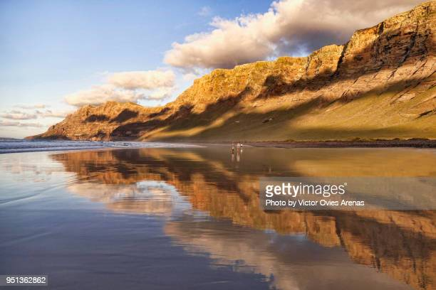 Low tide at Famara beach at sunset in Lanzarote, Canary Islands