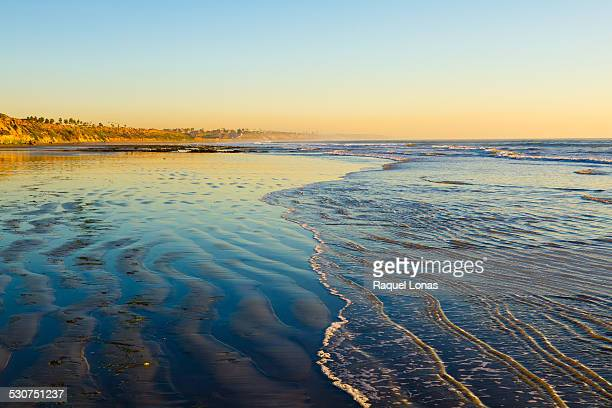 low tide on a flat bach at sunset - carlsbad california stock pictures, royalty-free photos & images