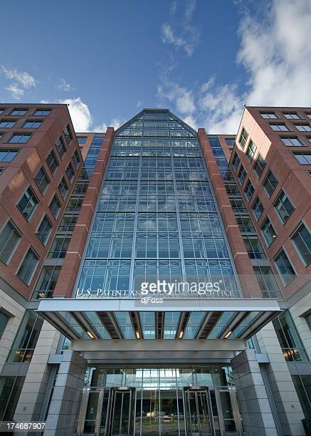 low view of a modern office building standing tall - intellectual property stock pictures, royalty-free photos & images