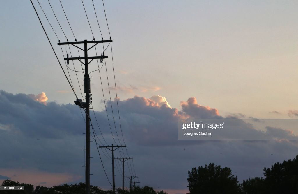 Low voltage power lines connecting residential neighborhoods to the power grid : Stock Photo