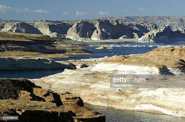 Low water leaves a white 'bathtub ring' of calcium carbonate that was deposited by the water at higher levels at Lake Powell as the fiveyearold...