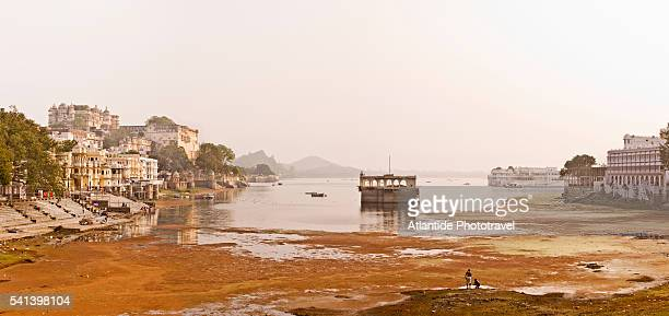 Low water level in Pichola Lake at the City Palace complex