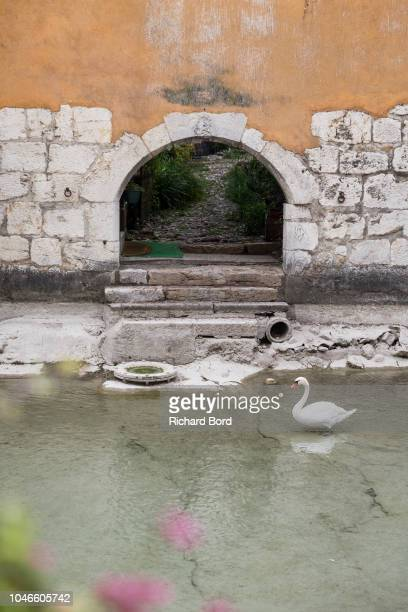 Low water level is seen in the old town of Annecy where the Thiou river is formed by the Annecy Lake water on October 6 2018 in Annecy France Lake...