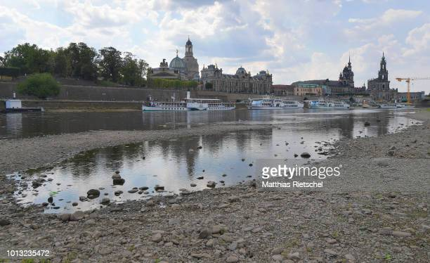 A low water level of Elbe river is seen opposite Dresden`s old town district during hot weather on August 8 2018 in Dresden Germany A heat wave and...
