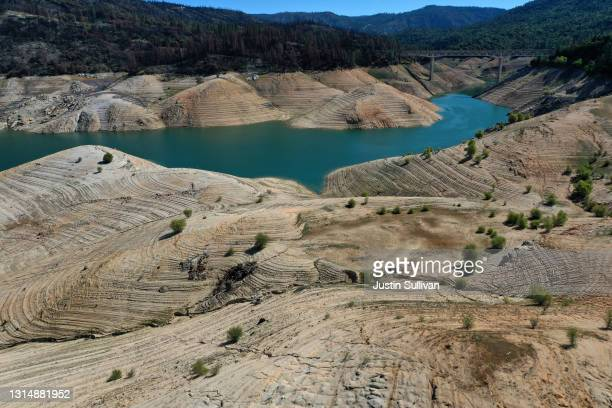 Low water levels are visible at Lake Oroville on April 27, 2021 in Oroville, California. Four years after then California Gov. Jerry Brown signed an...