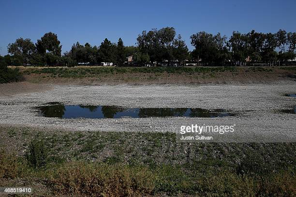 Low water levels are visible at the Los Capitancillos Recharge Ponds on April 3, 2015 in San Jose, California. As California enters its fourth year...