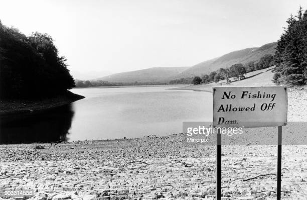 Low water levels at Dolygaer Reservoir in the Brecon Beacons, south Wales, 25th July 1990. Sign, No Fishing Allowed Off Dam.