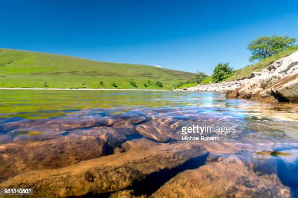 Low water on the Grwyne Fawr reservoir, Black Mountains, Wales, in a drought