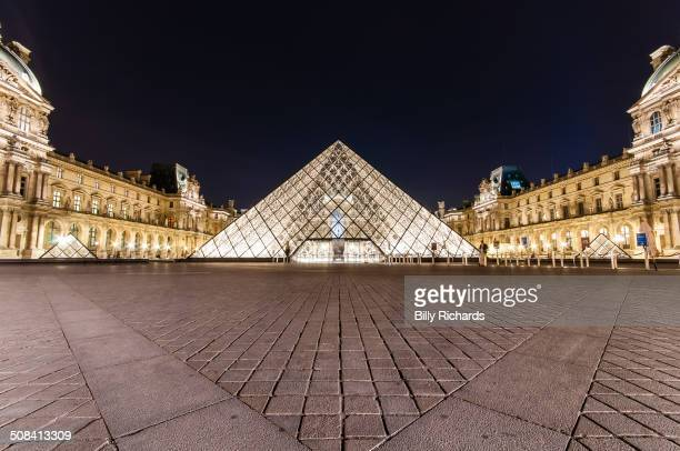 CONTENT] A low wide angle shot of the main glass pyramid of the Louvre Museum in Paris France The paving on the ground gives strong perspective and...