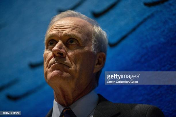 Lowangle headshot of Secretary of the Navy Richard V Spencer against a blue background July 12 2018 Image courtesy Sgt Akeel Austin/Marine Corps Air...