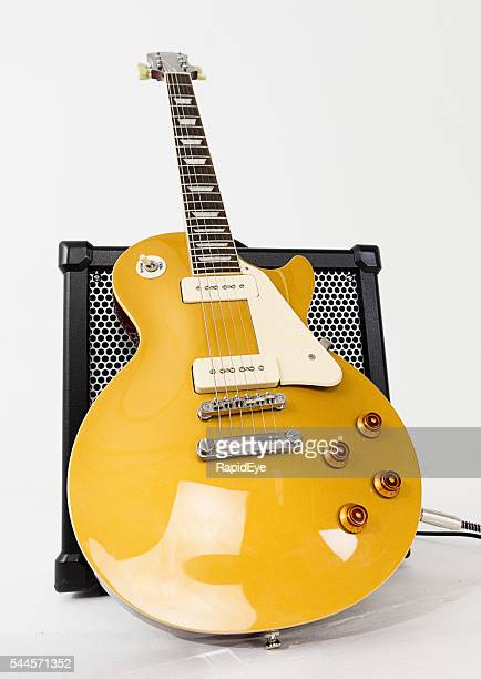 Low-angle look at '56 Les Paul Pro guitar with amplifier