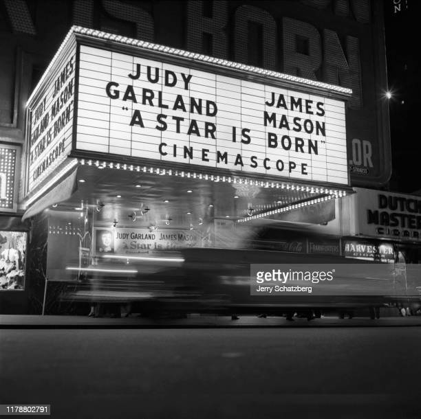 Low-angle, nighttime view of the marquee of the Victoria Theatre which advertises 'A Star Is Born' , New York, New York, 1954.