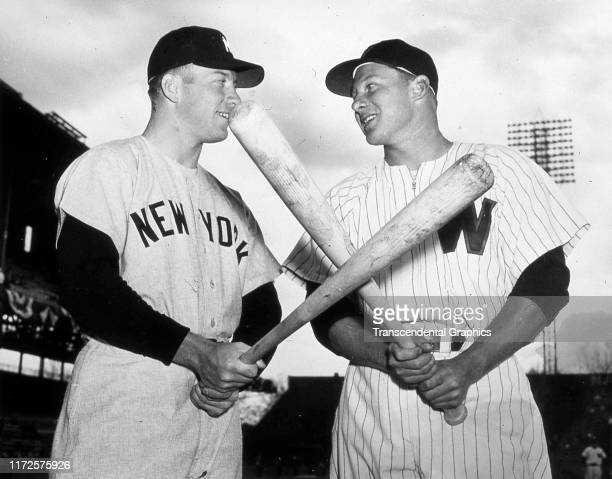 Lowangle portrait of American baseball player Mickey Mantle of the New York Yankees and Jackie Jensen of the Washington Senators at Griffith Stadium...