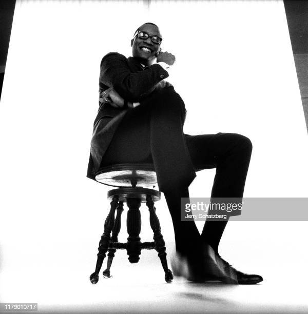 Lowangle portrait of American Jazz composer and musician Ramsey Lewis as he poses on a stool in front of a white background New York New York January...