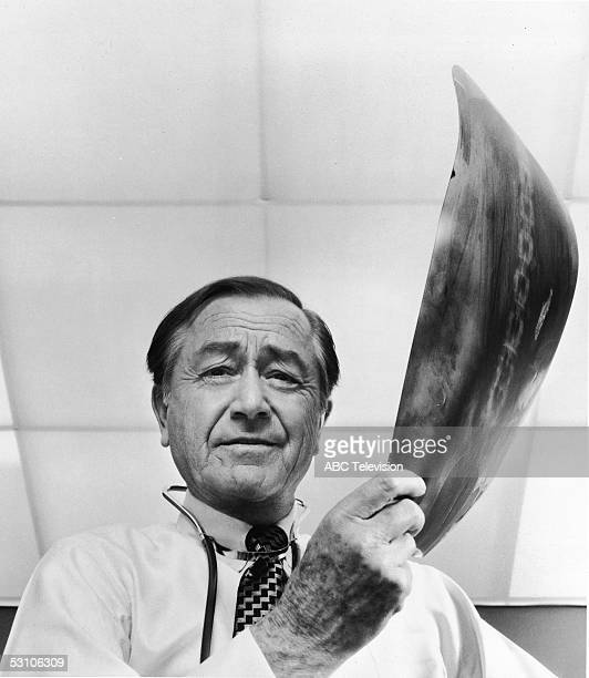 Lowangle promotional still of American actor Robert Young as Dr Marcus Welby from the ABC medical drama 'Marcus Melby MD' 1970s Young holds an xray...