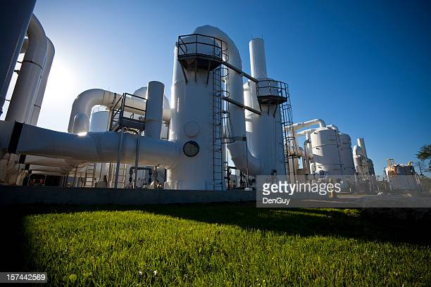 Low-angle shot of water purification plant, shadows on grass