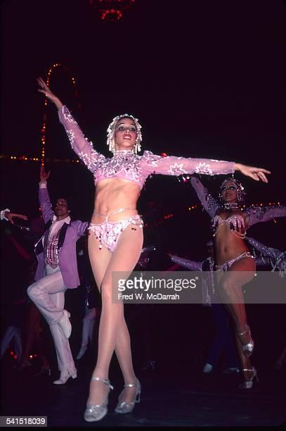 Lowangle view of a costumed dancers at the Cabaret Tropicana Havana Cuba January 29 1983