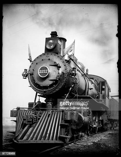 Lowangle view of a locomotive with an attached cowcatcher late nineteenth or early twentieth century