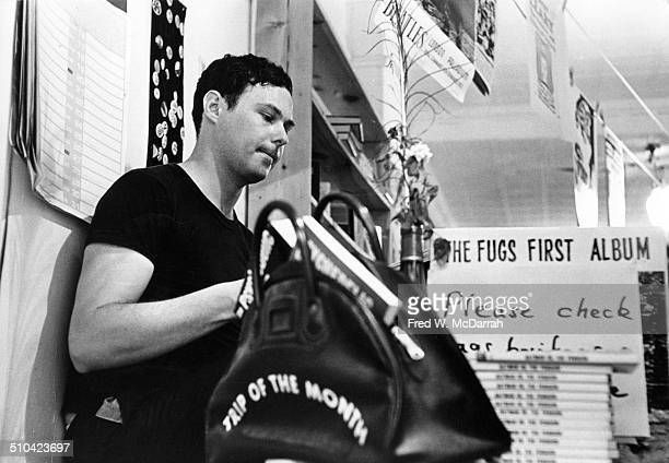 Lowangle view of a man in the East Side Bookstore New York New York June 24 1966 The bag in the foreground is labeled 'Trip of the Month' while is...