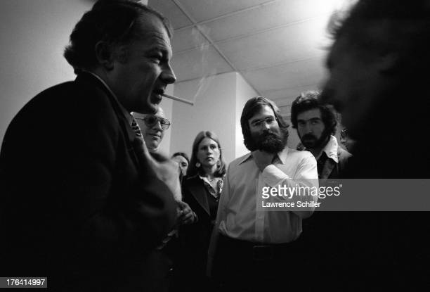 Lowangle view of American attorney F Lee Bailey as he speaks with unidentified members of the press San Francisco California 1976 At the time Bailey...