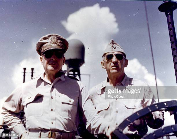 Lowangle view of American military commanders General Douglas MacArthur and Lieutenant General Walter Krueger aboard a PT boat in the Leyte Gulf...