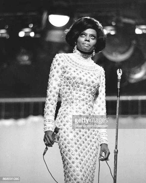 Lowangle view of American Pop and Rhythm Blues singer Diana Ross of the Supremes as she performs on an unspecified television show late 1960s