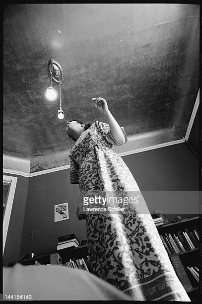 Lowangle view of an unidentified woman as she stares at a light bulb during an LSD trip Los Angeles California 1966 The woman took the acid as part...