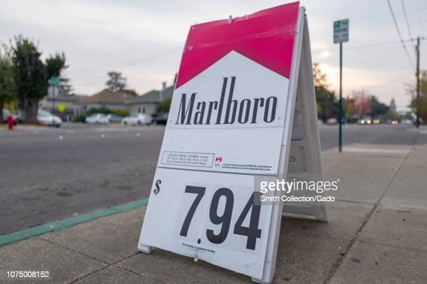 Lowangle view of folding sign with logo for Marlboro cigarettes a brand of tobacco conglomerate Philip Morris with price exceed seven dollars in...