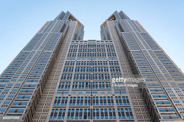 Low-angle view of frontal facade of Tokyo Metropolitan Government Building, Shinjuku, Japan.