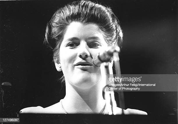 Lowangle view of Luci Baines Johnson daughter of American President Lyndon Baines Johnson as she speaks into a microphone 1960s Photo by...