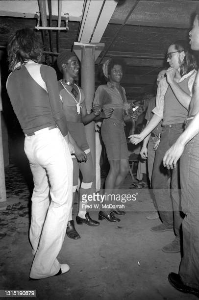 Low-angle view of men as they dance at former firestation turned community center, the Gay Activist Alliance Firehouse, New York, New York, June 11,...