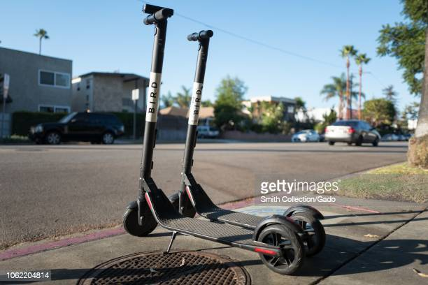Lowangle view of several motor scooters from sharing economy company Bird parked along a street in the Marina Del Rey neighborhood of Los Angeles...