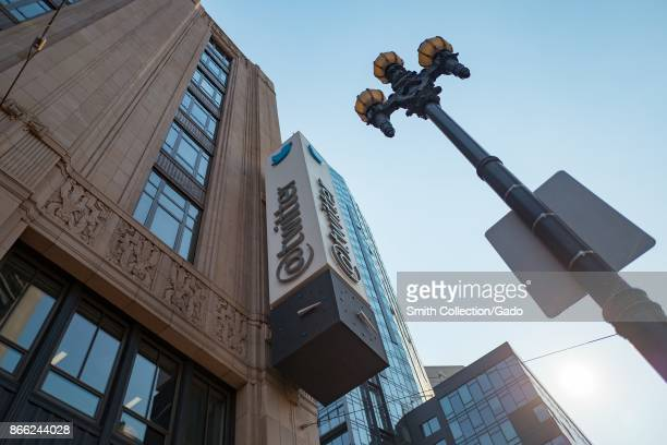 Lowangle view of sign with logo on the facade of the headquarters of social network Twitter in the South of Market neighborhood of San Francisco...